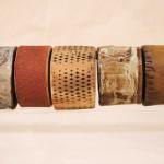 Maura Allen, Cowboy Code X, ceramic/iron, 6 x 28 x 4.
