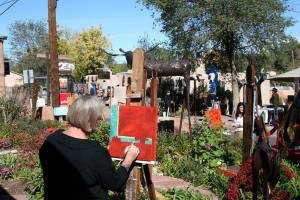 Artists paint and attendees peruse the galleries along Canyon Road during last year's paint-out.