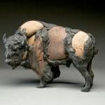 Pete Zaluzec | Bison, river stone/bronze, 13 x 8 x 5.