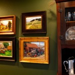 Four works depicting old trucks by Teresa Vito, Carol Jenkins, Tom Lockhart, and Douglas Morgan in Bullards mountain home.