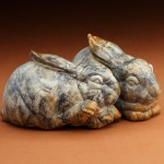 Joshua Tobey, Snuggle Bunnies, bronze, 4 x 4 x 6 each.